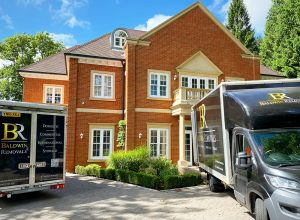 Removal Van outside large red bricked detached house